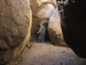 Logan tunneling around in the Wonderland of Rocks.