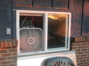 A box fan in the same window.  I open all the windows and run this fan overnight, then turn off the fan, close the windows and cover them with insulation when I get up in the morning.  I usually train within an hour or two of waking up, so I leave everything sealed throughout the workout.