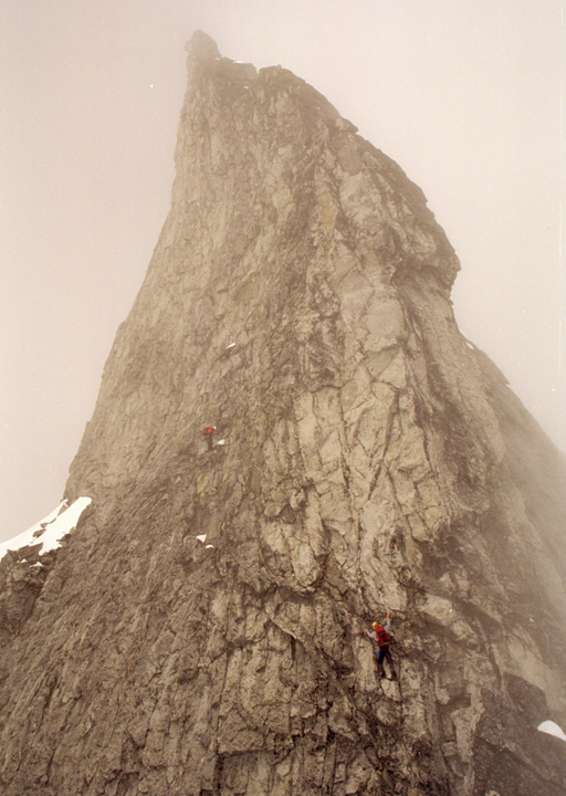 Marc Spriner (R) and I climbing into marginal weather on Devil's Thumb, Alaska.