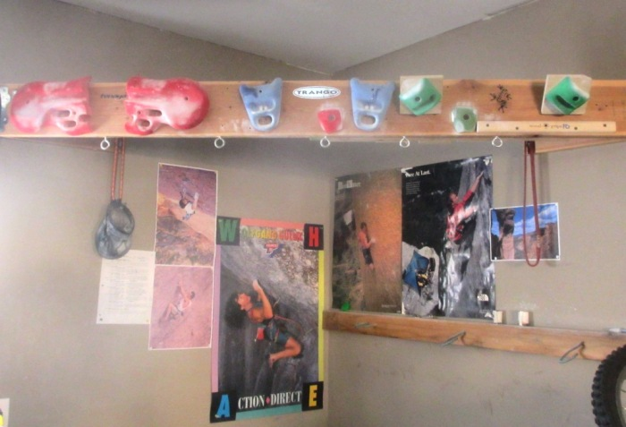 My old hangboard setup.  A ridiculous amalgamation of modified hangboards, holds, rock rings and system tiles