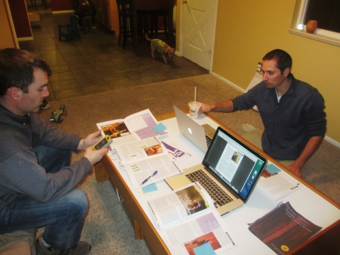 The Fixed Pin brain trust examining each page of the book for errors.  Ben on the left, Jason on the right.