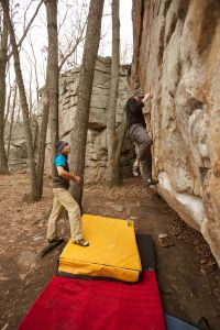 "Shaun gets ""expert feedback"" from Mike on the Jerry Lewis boulder at Little Rock City, TN. (c) Janelle Anderson"