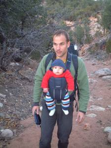 A Baby Bjorn lets you wear your climbing pack. Never leave a child with a man like this!