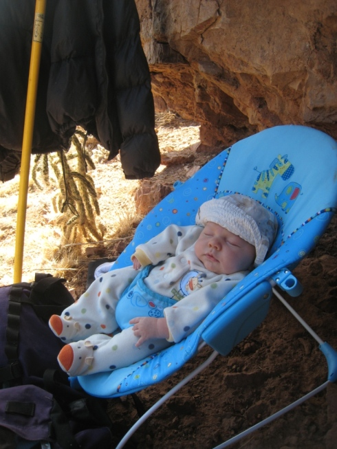 Our trusted bouncy seat has served us well for 3 years.  Note the stick clip and down jacket poised to create shade in the upper left.