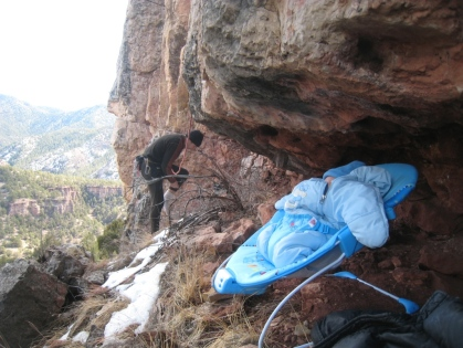 Logan perched under a low roof at Shelf Road to protect from rock fall.