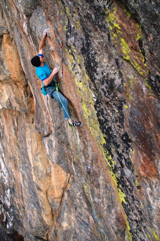 Entering the 'Impossible' crux, with my right hand on the incut horn, and left on the lowest 'razor crimp'.