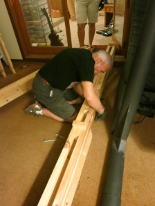 My Dad, Marshall, fastens 3 bolts to secure the lap joints for the left main support beam.