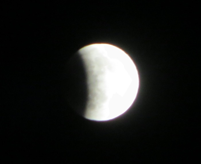 Last night's Lunar Eclipse from my house.  I'm sure it got even better than this, but I couldn't stay up that late :)