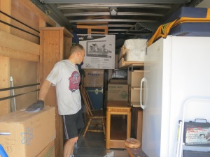 "Playing ""Tetris"" with all our worldly possessions.  The Campus board is strapped to the wall to my left."