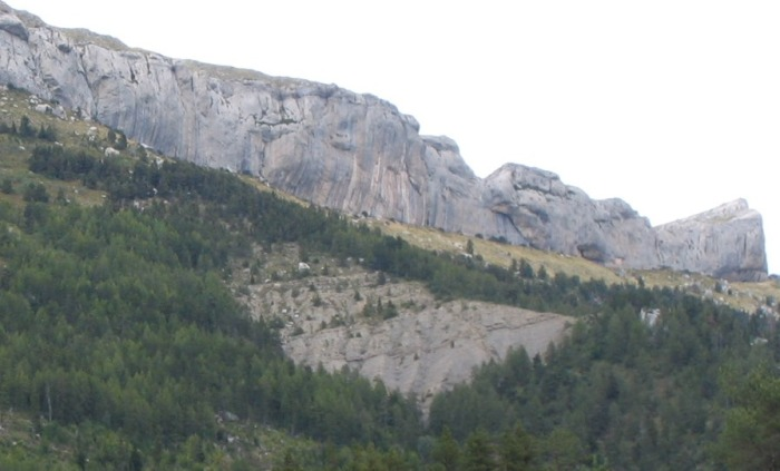 Realization is located on the Sector Biographie, which is the tallest and steepest section of cliff near the center of the photo.