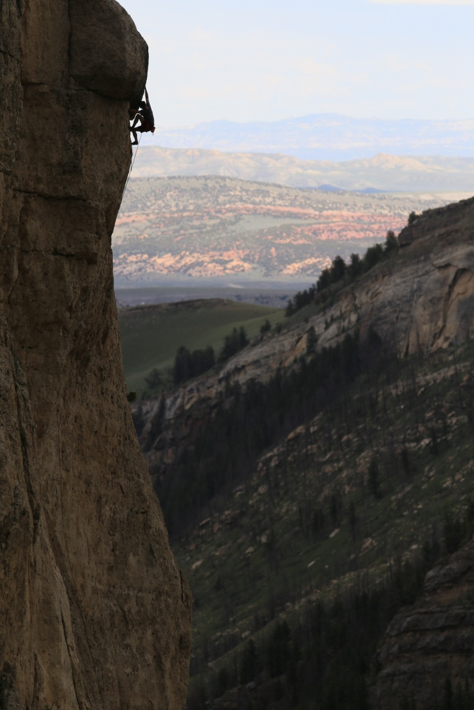 "Las Vegas climber, and all-around awesome dude, Rob Jensen climbing ""Dominant Species"" 5.11d.  That's Red Canyon in the background."