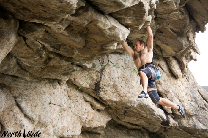 Figuring out the foot sequence before the FA of Full Metal Jacket, 5.13c.  Photo Keith North.
