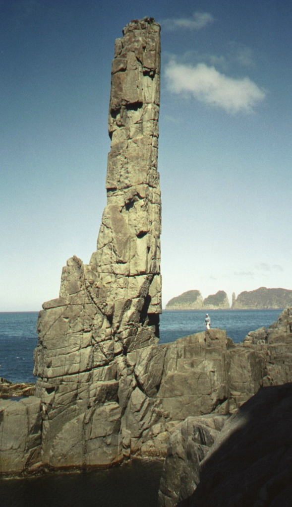 Cape Hauy in the distance.  The slender tower is The Candlestick, which sits about 20 feet east of The Totem Pole.