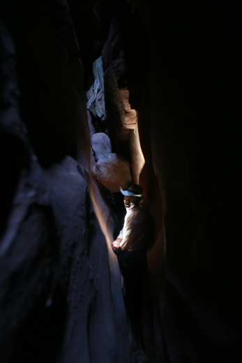 Deep in the slot it was so dark we needed a headlamp, but when we lit it up, we could see the walls were covered with spiders!