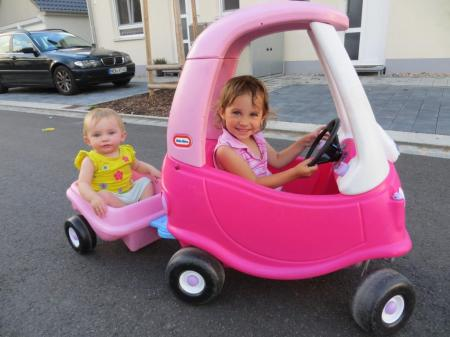 Amelie's cousin Lauren takes her for a ride in Weiden.