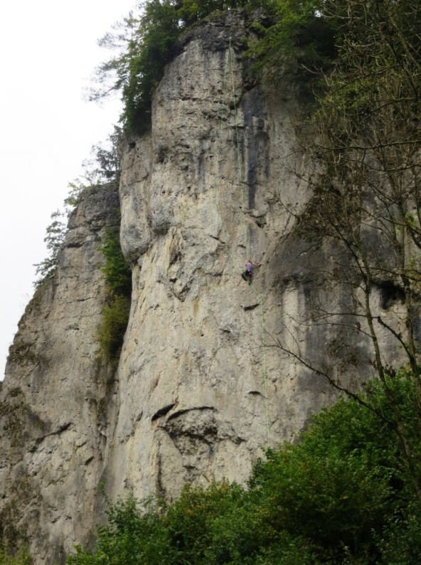 Kate climbing 40-meters of gently overhanging 5.10 pockets at Roter Fels
