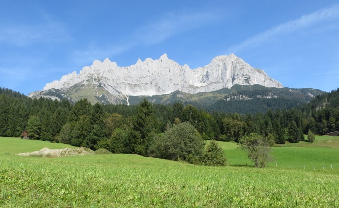 Wilder Kasier.  The Schleierwasserfall is hidden in the pine-covered foothills.