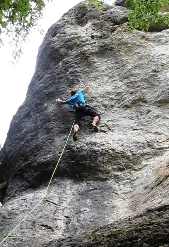 Beginning the crux with a static reach to a left hand mono.