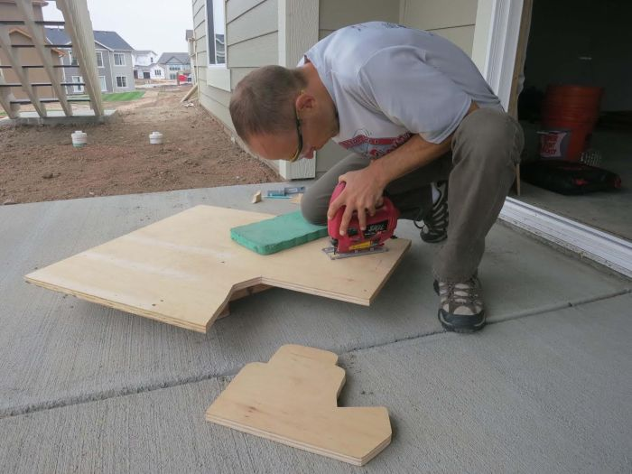 "Cutting the 3/4"" plywood base board with a jig saw. Use safety glasses!!!"