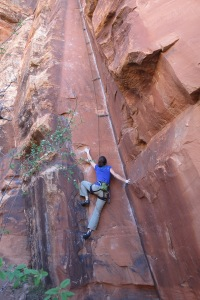 Janelle starting up the OUTSTANDING route, Inner Chi ~ at the Kung Fu Theater crag.