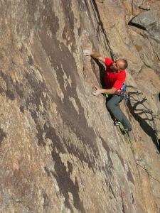 Psyching up for the crux at the mini-ledge.