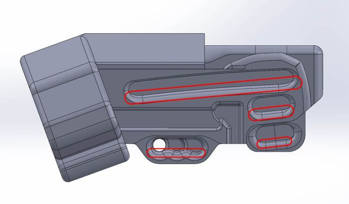 CAD model of the Forge. The draft that was added to all of the pockets is apparent in this screen capture, indicated by the extra line at the bottom of each pocket (and circled in red).