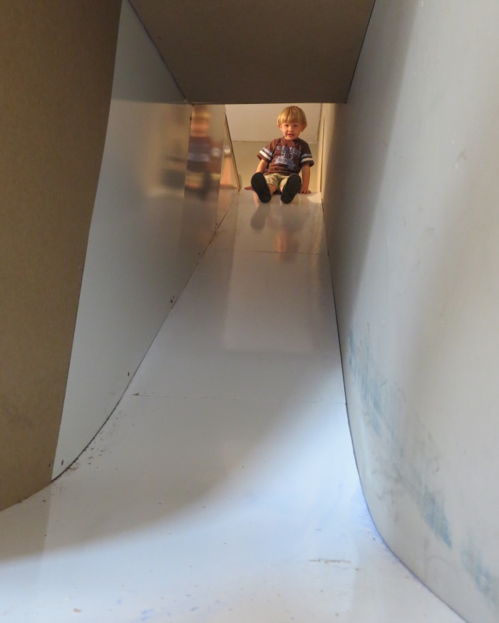 "Logan about to test the slide tunnel. I created the curvature at the bottom of the slide by laminating two sheets of ¼"" plywood together."