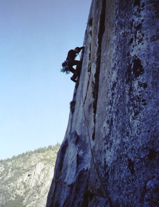Mike traversing out to the start of the Monster Offwidth on Freerider, May 2004.