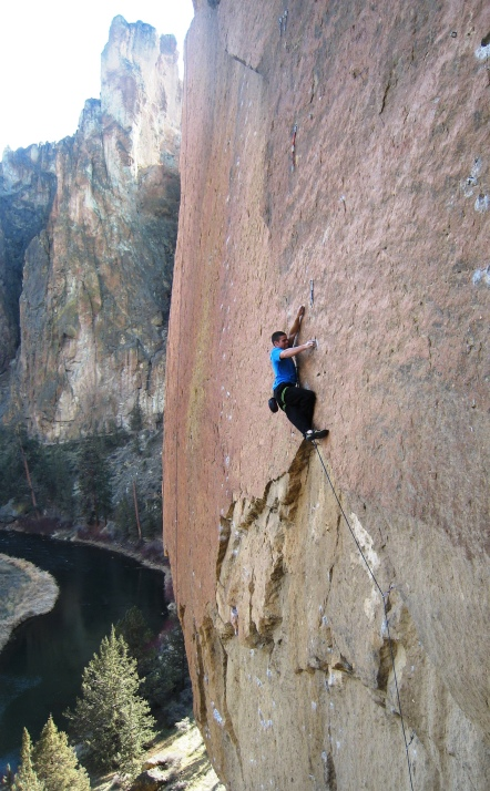 Fred Gomez cool and collected on his send of Smooth Boy, 13b, Smith Rock, OR.