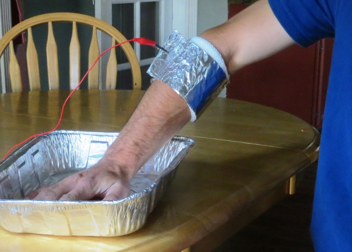 "Wrapping foil around the wristband will greatly increase conductivity, reducing the amount of current required and decreasing current density where the wire is attached. This piece of foil is approximately 12"" x 18"". Fold it twice length-wise to create a strip 3""x18"", and wrap that around the dampened wristband. Roll the two ends together and clip the wire to the roll."
