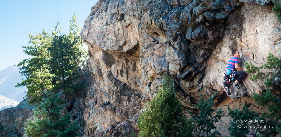 Just after topping out the crux mantle of Aftermathematics, 5.12a. Photo Nicholas Zepeda.