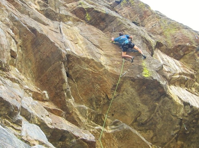 Cranking between incut crimps on the pumpy, slightly overhanging headwall.